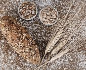 stock photo of whole-wheat  - Whole wheat bread with seeds on table with flour - JPG