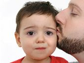 stock photo of feeling better  - Father kisses crying son - JPG