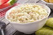 image of corn  - A bowl of delicious creamy homemade coleslaw on a rustic picnic table with watermelon and corn - JPG