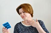 picture of throat  - Adult woman with a sore throat on a light background - JPG