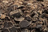 stock photo of grating  - Grated dark chocolate Close up shot Food backgrounds - JPG