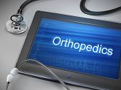 picture of orthopedic surgery  - orthopedics word displayed on tablet with stethoscope over table - JPG