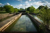 pic of sedimentation  - The slime covered sedimentation tanks or pools of an old abandoned water sewage treatment facility - JPG