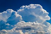 stock photo of storms  - Large Puffy Cumulonimbus Storm Cloud - JPG