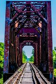 picture of trestle bridge  - Vanishing Point View of an Old Railroad Trestle with an Old Iconic Iron Truss Bridge Over the Brazos River - JPG
