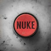 foto of nuke  - Grungy Industrial Style Button With Work Nuke - JPG