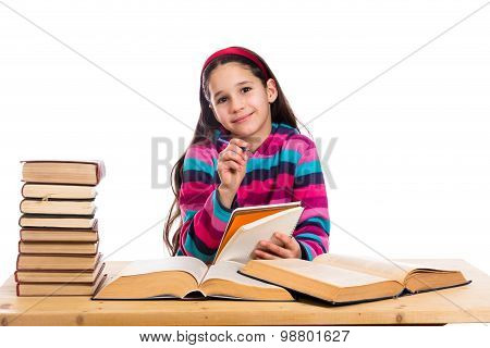 creative girl with pile of books
