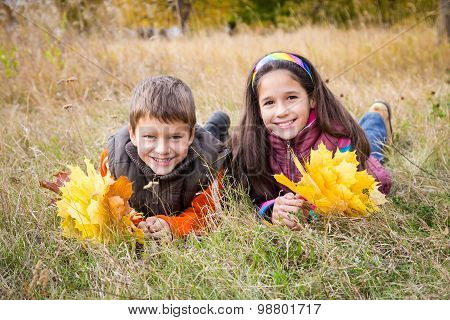 kids with autumn leaves