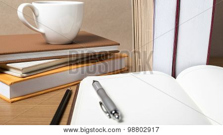 Open Notebook With Book And Coffee Cup