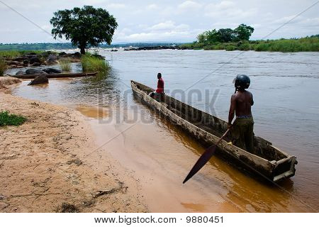 Men In A Wooden Boat On The River Congo