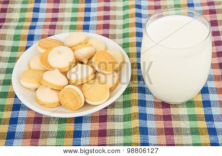 Cookies With Egg Glaze In Wicker Basket And Glass Milk