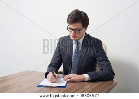 A Lawyer Is Signing The Contract. A Concept Of Contract Drafting Procedure.