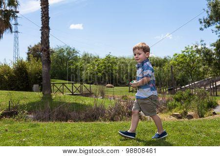 Child Boy Walking In Park