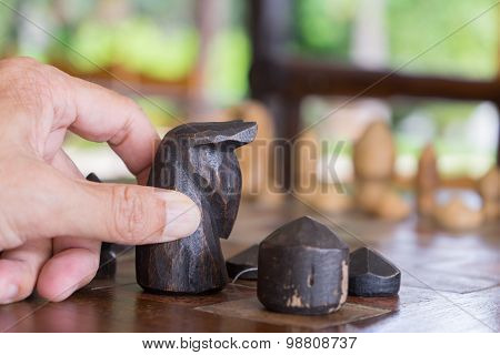 Man Hand Moving Wooden Chess