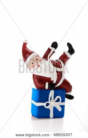 Father Christmas Lying On Present Isolated On White