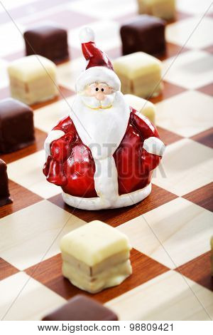 Dominostein Christmas Pastry  With Chocolate Icing On Chess Board