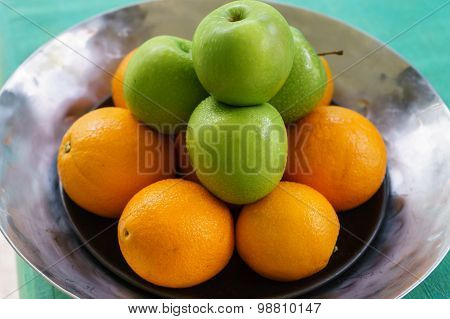 Orange And Green Apple On A Tray