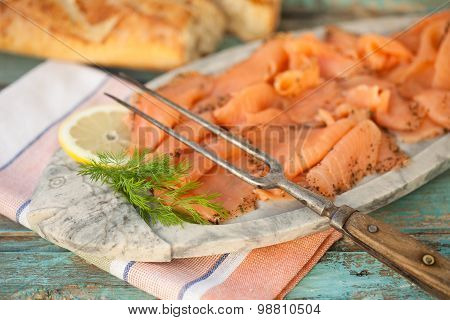 Close Up Of Marinated Cold Cuts Of Salmon With Fork