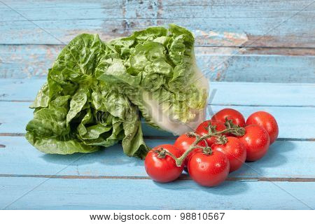 Close Up Of Mini Romaine Lettuce And Vine Tomatoes