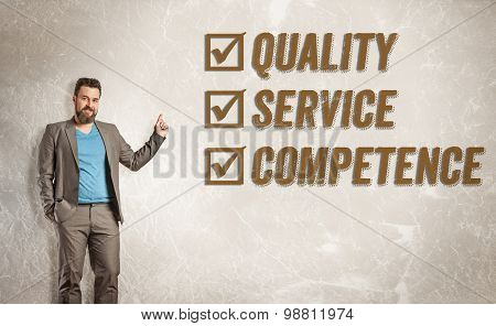 Businessman Pointing Up Towards Text, Quality, Service, Competence