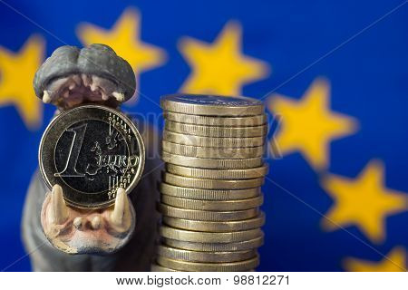 Euro Coin In Mouth Of Hippo Figurine, Eu Flag