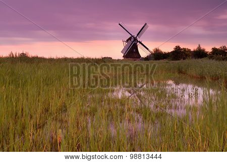 Dutch Windmill At Purple Sunrise