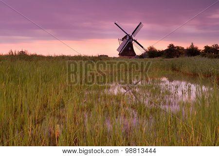 Dutch Windmill At Purple Sunrise