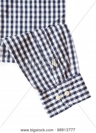 Black and white check shirt sleeve and button on white background