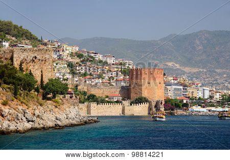 Alanya, Turkey, Jule 25, 2015. Wall of fortress and Red Tower (Kizilkule) in Alanya