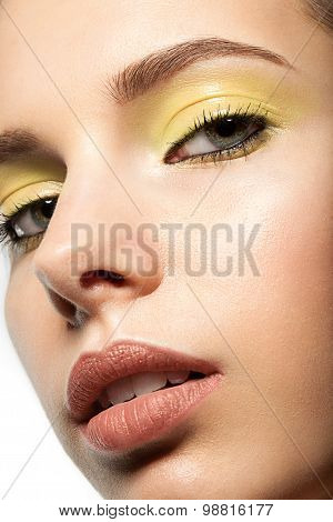 Professional makeup closeup with yellow eye shadow close-up