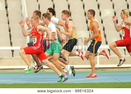 BARCELONA - JULY, 10: Competitors on start of 100m of Decathlon  men during the 20th World Junior Athletics Championships at the Olympic Stadium on July 10, 2012 in Barcelona, Spain
