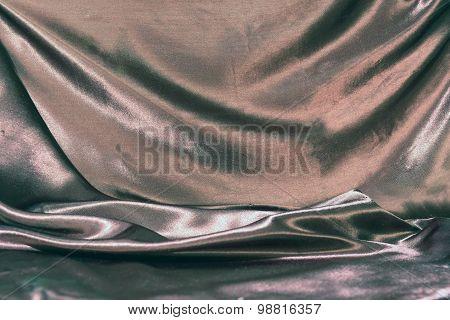 Undulating Folds Of The Fabric Of Black Silk