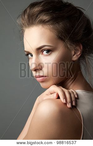 Close-up portrait of a blonde young pretty woman with natural make-up