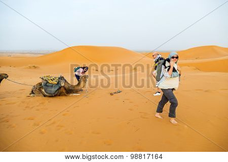Dunes Erg Chebbi near Merzouga, Morocco - tourist during a camel tour into the erg