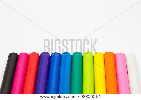 Art rainbow colours clay sticks on white background