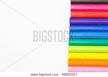 Colourful art clay sticks on white background