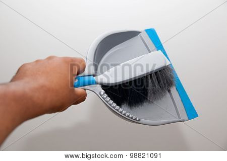 Hand With Dustpan And Brush