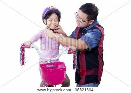 Dad Helps His Child To Fasten Helmet