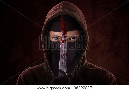Frightening Man Holding Bloody Knife