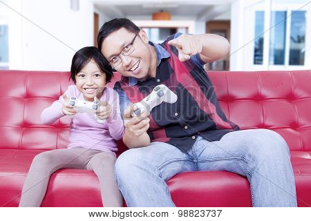 Little Girl Playing Video Game With Dad