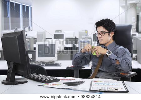 Male Worker Holding Coffee In The Office