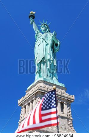 Statue Of Liberty With Small American Flag