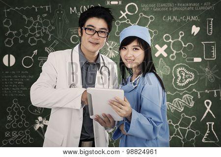 Medical Team With Digital Tablet
