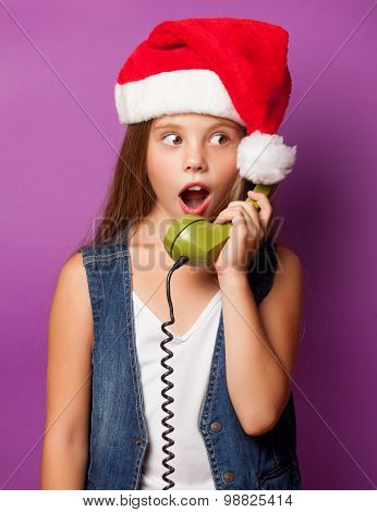 Girl In Red Santas Hat With Green Handset