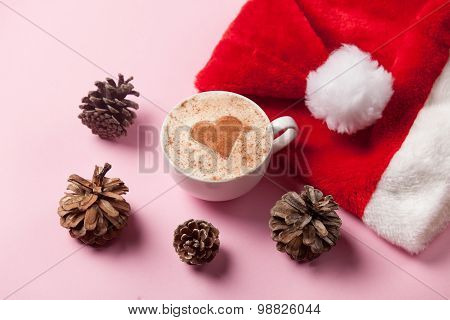 Cup Of Coffee With Heart Shape And Pine Cones