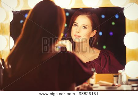 Portrait Of A Beautiful Woman As Applying Makeup