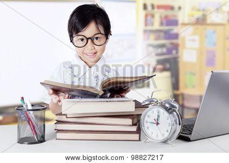 Sweet Kindergarten Student Reading Book