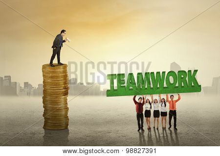 Teamwork Lift A Text Commanded By Their Boss