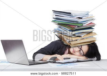 Tired Businesswoman Sleeping With Paperwork