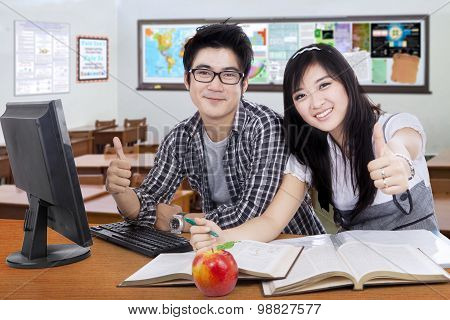 Two Students Shows Thumbs Up In The Class